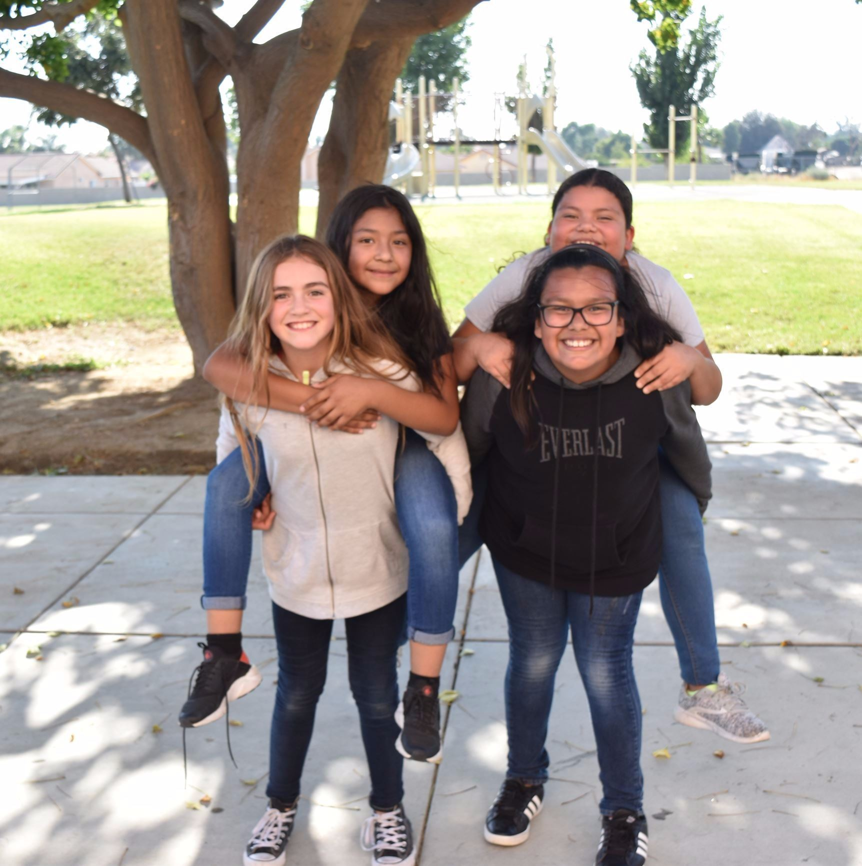 4 Girls Giving Piggyback Rides Posing for Picture