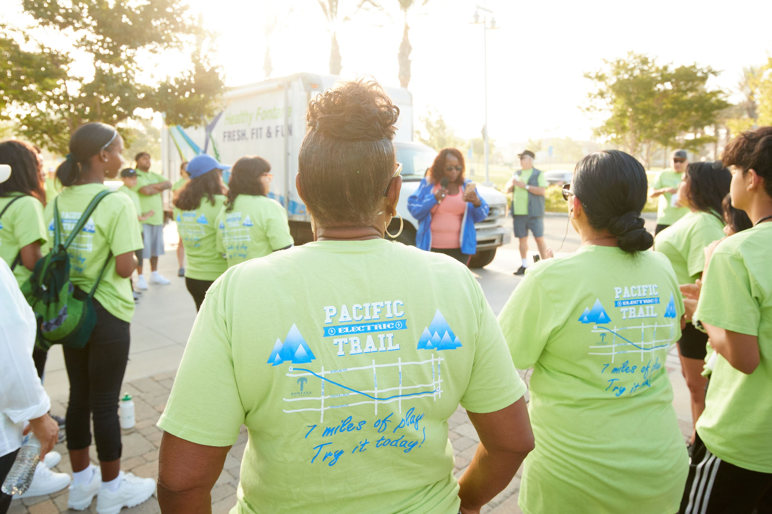 Back view of green Fontana Walks shirts worn by participants