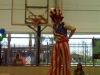 Person on stilts making a slam dunk
