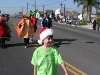 Kid wearing a Santa hat in the parade