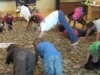 Kids doing downward dog yoga position
