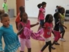 Kids dancing in a line