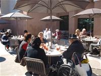 Seniors enjoy lunch on the patio