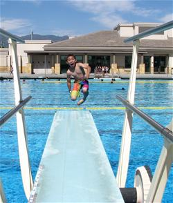 Boy jumpin off diving board